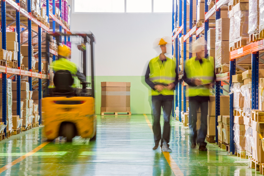 Men working and shifting and taking stock count in warehouse