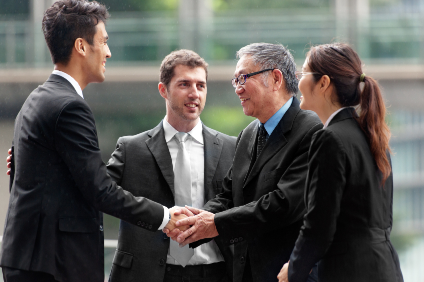 Men and woman in business suit shaking hands business agreement