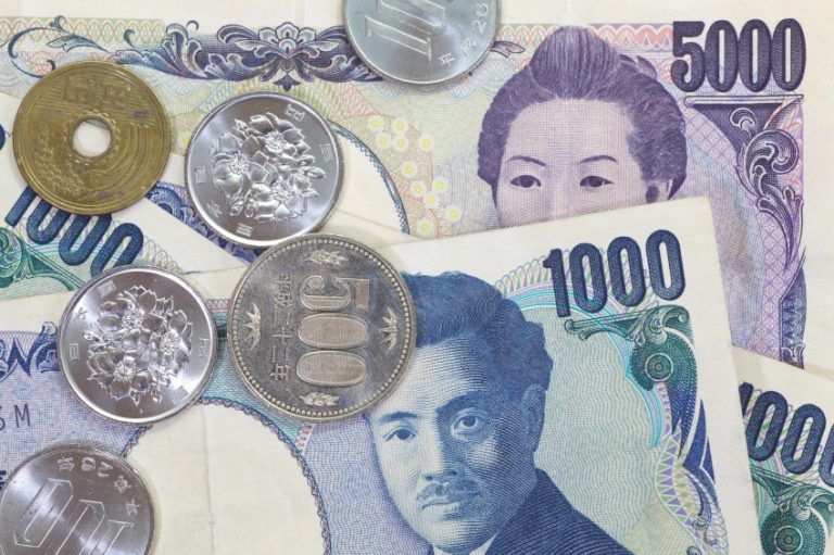 Japanese Yen currency dollar notes and coins